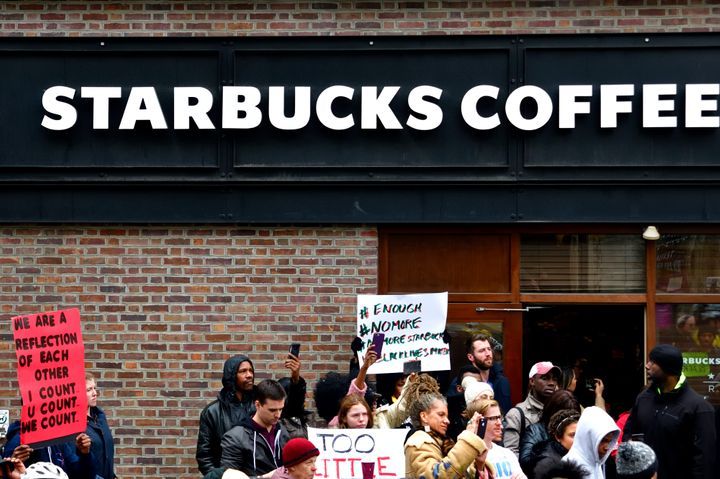 Protesters gather on April 15 at the Philadelphia Starbucks location where two black men were arrested days earlier.