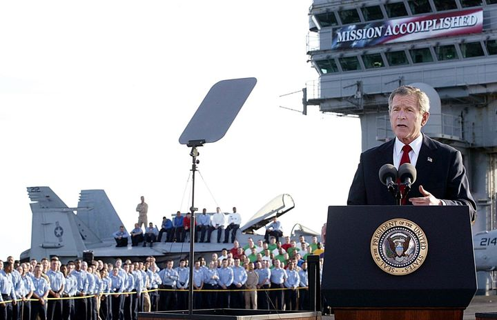"President George W. Bush addresses the nation on May 1, 2003, in front of the now-infamous ""Mission Accomplished"" banner"