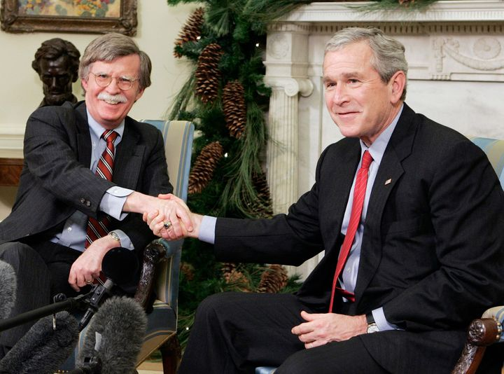 Bush's United Nations representative John Bolton shakes hands with the president in 2006. Bolton is now advising President Do