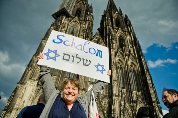 Activists holding a signduring a rally in front of Cologne Cathedral on April 25, 2018, in Cologne, Germany.