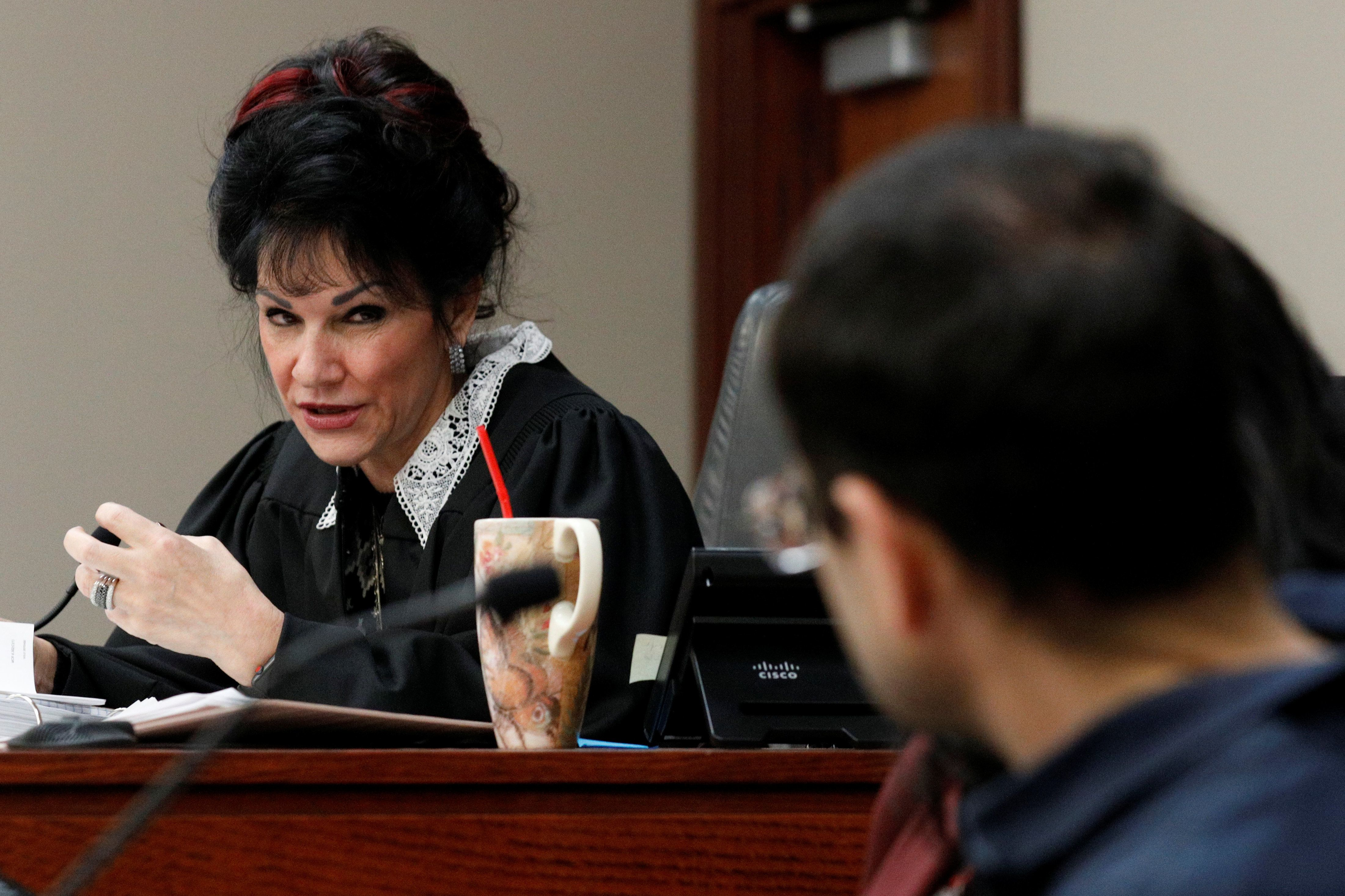 Circuit Court Judge Rosemarie Aquilina addresses Larry Nassar, (R) a former team USA Gymnastics doctor who pleaded guilty in November 2017 to sexual assault charges, during his sentencing hearing in Lansing, Michigan, U.S., January 18, 2018. REUTERS/Brendan McDermid