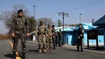 PANMUNJOM, SOUTH KOREA - APRIL 18:  South Korean and U.S. soldiers stand guard at the border village of Panmunjom between South and North Korea at the Demilitarized Zone (DMZ) on April 18, 2018 in Panmunjom, South Korea. South Korean President Moon Jae-in and North Korean leader Kim Jong-un will meet for the first time on April 27, 2018 in the Peace House, a South Korean building inside Panmunjom.  (Photo by Chung Sung-Jun/Getty Images)