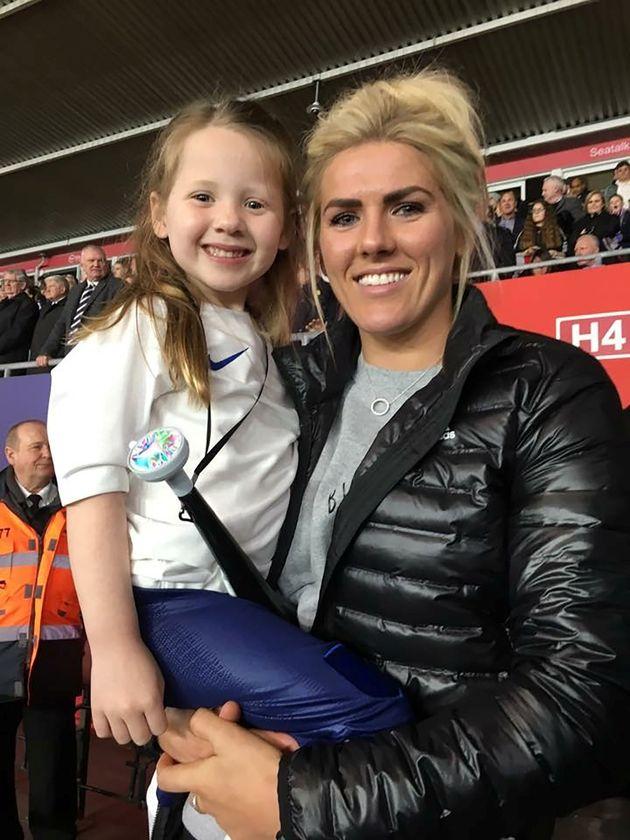 Jessie Adams with Millie Bright, a Sheffield player.
