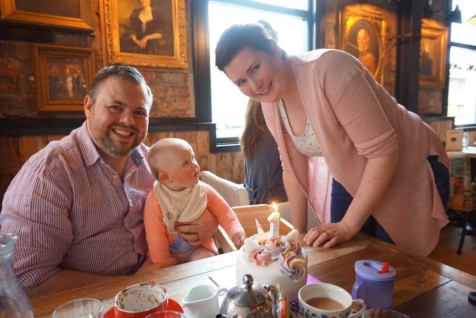 Sarah, her partner and her daughter Iris.
