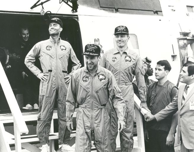 The Apollo 13 crew arrives safely on the U.S.S. Iwo Jima.