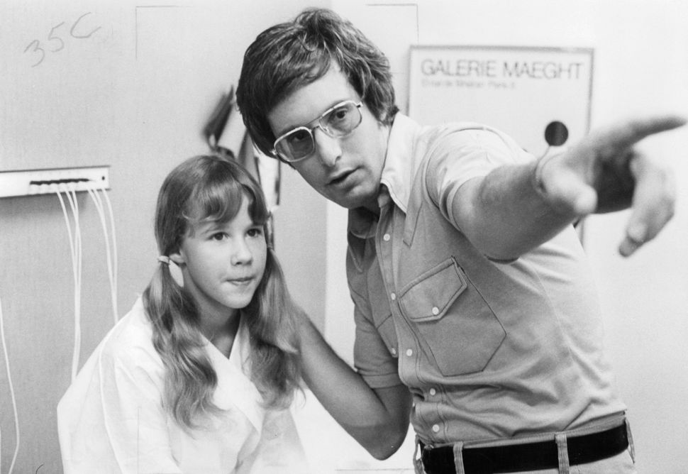 "Linda Blair and William Friedkin on the set of ""The Exorcist."""