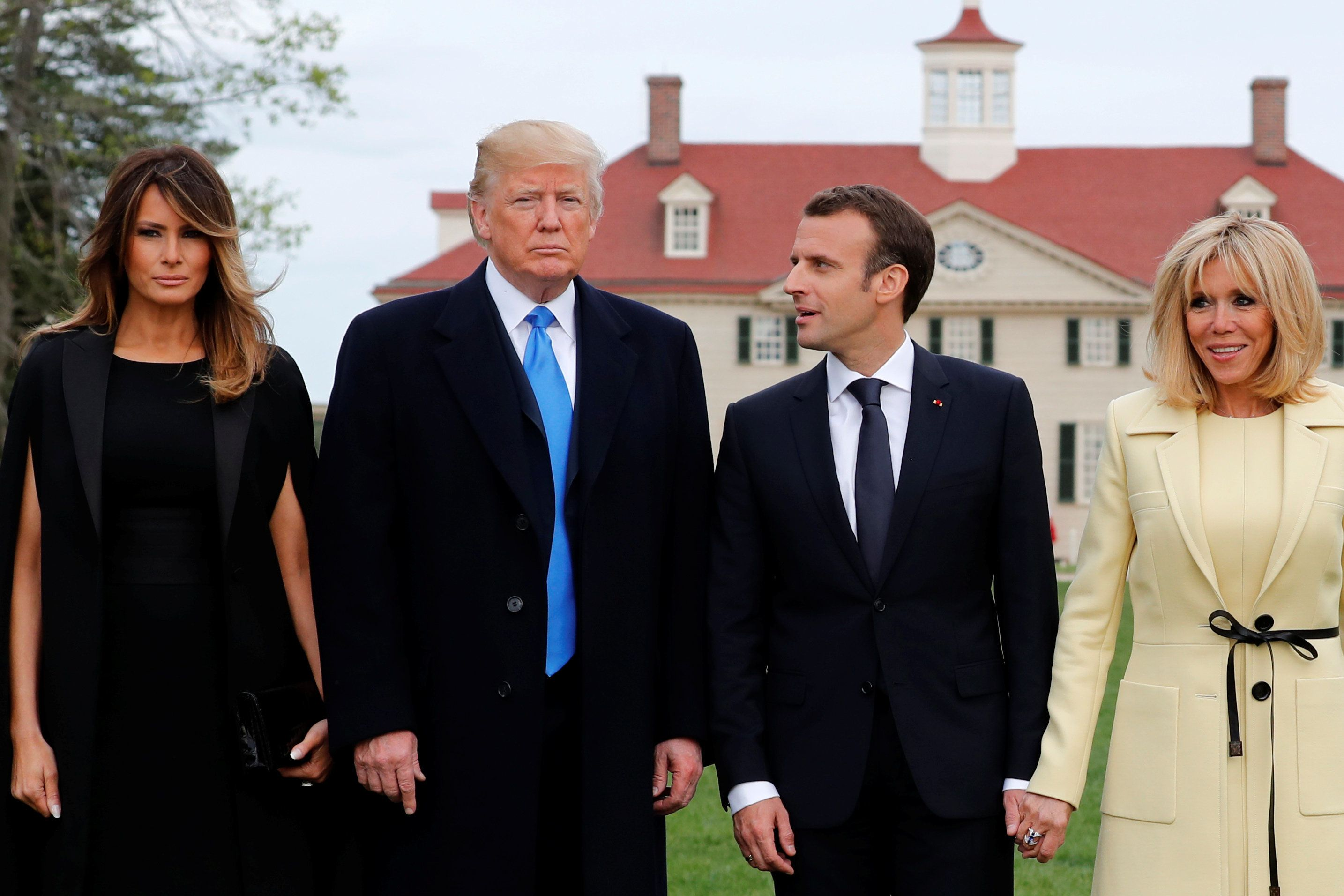U.S. President Donald Trump and first lady Melania Trump and French President Emmanuel Macron and Brigitte Macron have their picture taken on a visit to the estate of the first U.S. President George Washington in Mount Vernon, Virginia outside Washington, U.S., April 23, 2018. REUTERS/Jonathan Ernst