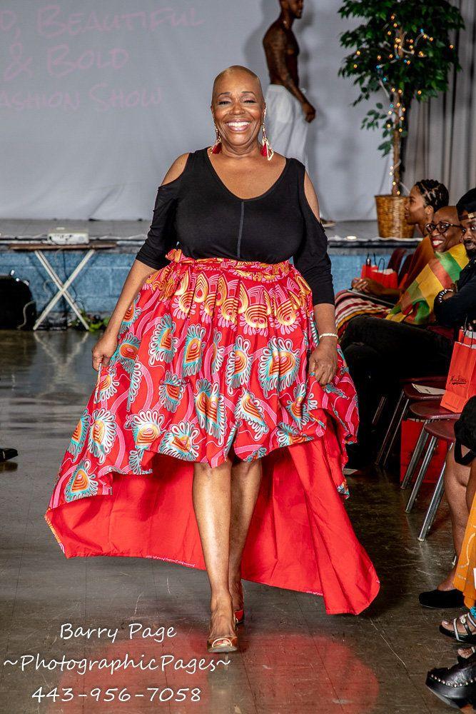 "A model walks in Alyscia Cunningham's ""I AmMore Than My Hair"" fashion show."