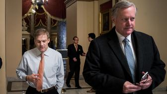 WASHINGTON, DC - DECEMBER 4: House Freedom Caucus member Rep. Jim Jordan (R-OH) walks with House Freedom Caucus chairman Rep. Mark Meadows (R-NC) on Capitol Hill, December 4, 2017 in Washington, DC. The House voted to formally send their tax reform bill to a joint conference committee with the Senate, where they will try to merge the two bills. (Drew Angerer/Getty Images)