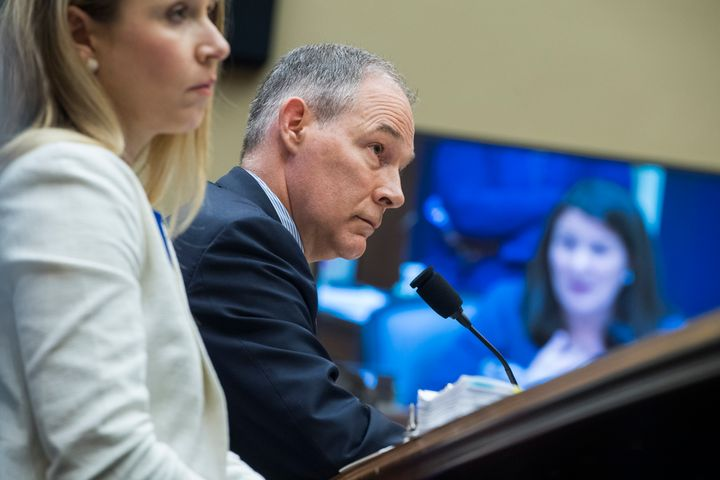 Scott Pruitt listens to a question by Rep. Diana DeGette, D-Colo., right, during his testimony before a House Energy and Comm