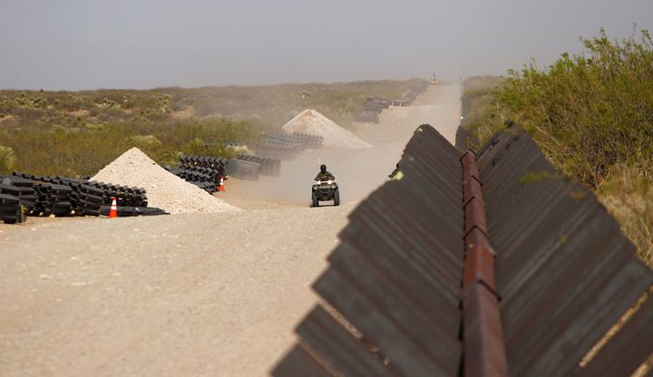 A U.S. Border Patrol agent rides his ATV along the border at the site of the construction of new wall in Santa Teresa, New Me