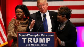 "The YouTube stars known as ""Diamond & Silk"" appear with Republican presidential candidate Donald Trump at his ""Rally to Benefit Veterans"" in Des Moines, Iowa January 28, 2016. REUTERS/Rick Wilking"