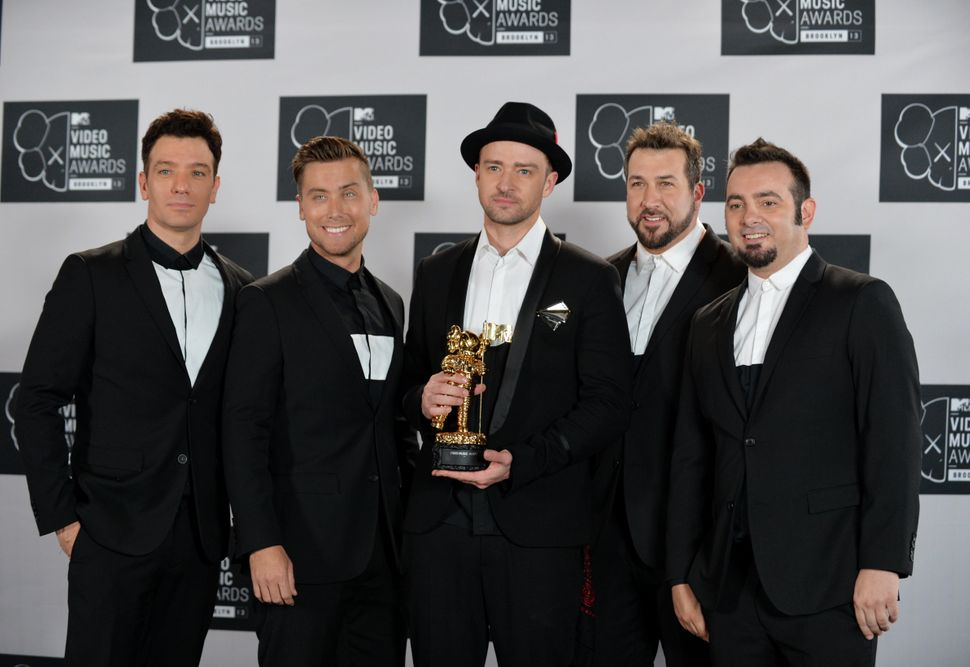 *NSYNC reunites for Justin Timberlake's Vanguard award performance at the 2013 MTV Video Music Awards.