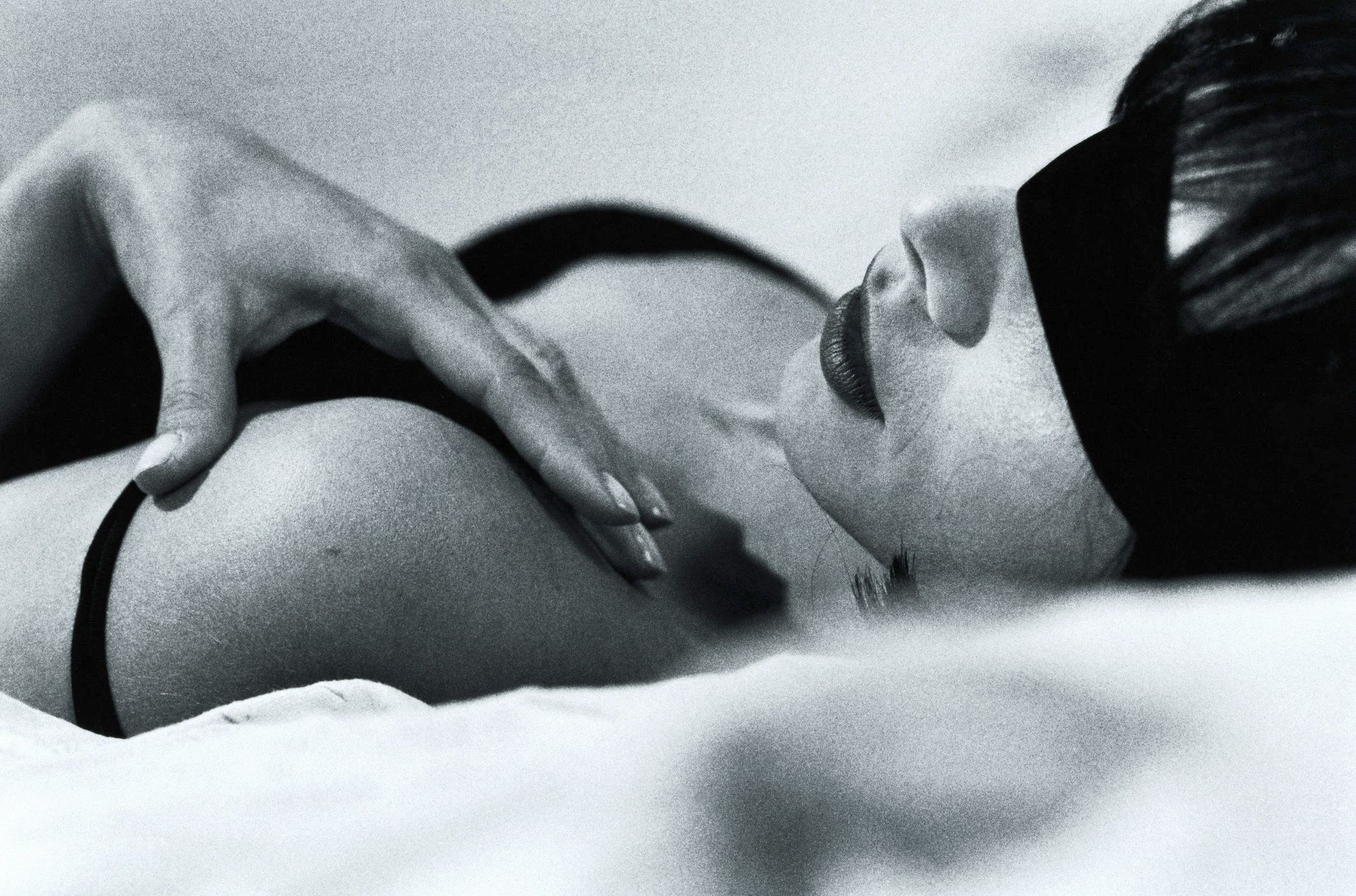 WOMAN LYING ON BED BLINDFOLDED (BLACK AND WHITE)