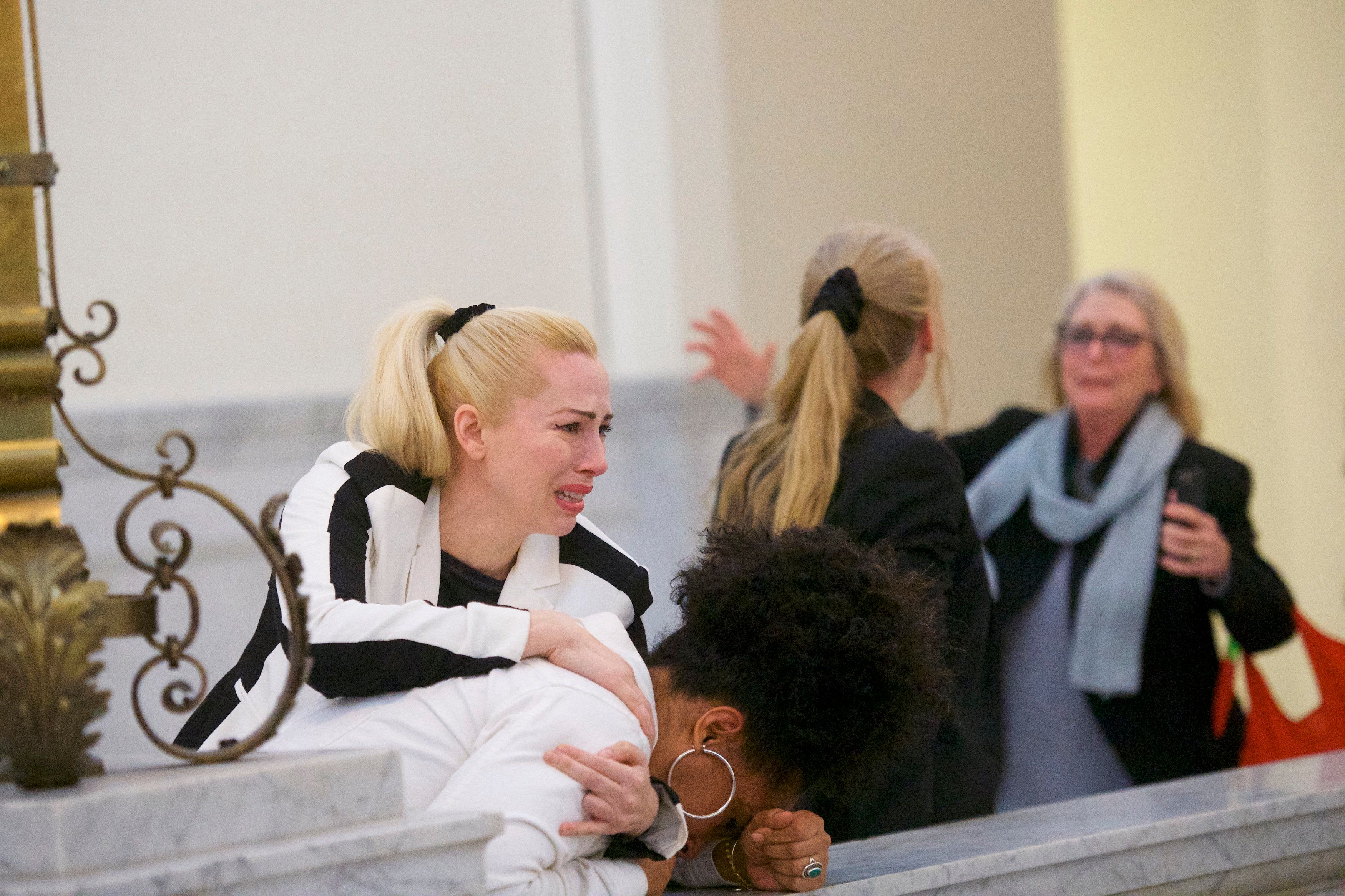 NORRISTOWN, PA - APRIL 26:  Bill Cosby accusers (L-R) Caroline Heldman, Lili Bernard and Victoria Valentino (far right) react after the guilty on all counts verdict was delivered in the sexual assault retrial at the Montgomery County Courthouse on April 26, 2018 in Norristown, Pennsylvania.  Cosby was found guilty on all accounts after a former Temple University employee alleges that the entertainer drugged and molested her in 2004 at his home in suburban Philadelphia.  More than 40 women have accused the 80 year old entertainer of sexual assault.  (Photo by Mark Makela/Getty Images)