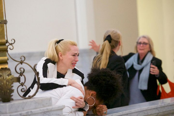 Caroline Heldman (left), Lili Bernard (bowed head) and Victoria Valentino (far right) react after the guilty verdict was deli