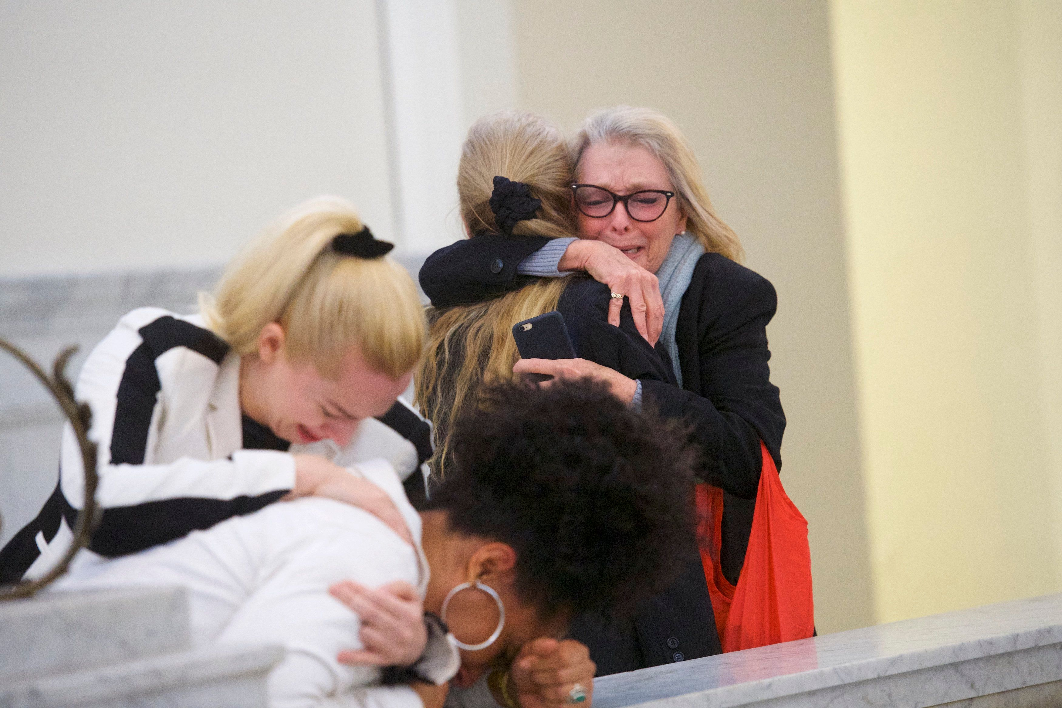 NORRISTOWN, PA - APRIL 26:  Bill Cosby accusers Victoria Valentino (R), Caroline Heldman (L) and Lili Bernard (2L) react after the guilty on all counts verdict was delivered in the sexual assault retrial at the Montgomery County Courthouse on April 26, 2018 in Norristown, Pennsylvania.  Cosby was found guilty on all accounts after a former Temple University employee alleges that the entertainer drugged and molested her in 2004 at his home in suburban Philadelphia.  More than 40 women have accused the 80 year old entertainer of sexual assault.  (Photo by Mark Makela/Getty Images)