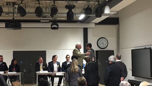 Usama Ghamhi jumped on the stage to confront the Tory candidates at the Kensington and Chelsea hustings.