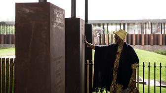 MONTGOMERY, AL - APRIL 26: Wretha Hudson, 73, discovers a marker commemorating lynchings in Lee County, Texas while visiting the National Memorial For Peace And Justice on April 26, 2018 in Montgomery, Alabama. Hudson, whose father's family came to Alabama from Lee County decades earlier, said the experience was overwhelming. 'It's a combination of pride and strength, for my people. In our culture, rain is a sign of acceptance from our ancestors. So the rain is a sign of their acceptance for this day.' The memorial is dedicated to the legacy of enslaved black people and those terrorized by lynching and Jim Crow segregation in America. Conceived by the Equal Justice Initiative, the physical environment is intended to foster reflection on America's history of racial inequality. (Photo by Bob Miller/Getty Images)