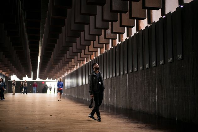 Veric Lang, 19, visits the National Memorial for Peace and Justice at its opening Thursday in Montgomery,