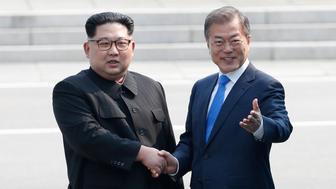 South Korean President Moon Jae-in and North Korean leader Kim Jong Un meet in the truce village of Panmunjom inside the demilitarized zone separating the two Koreas, South Korea, April 27, 2018.     Korea Summit Press Pool/Pool via Reuters