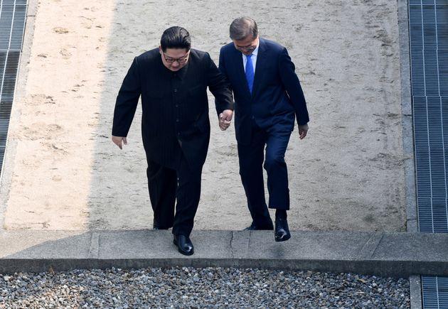 South Korean President Moon Jae-in and North Korean leader Kim Jong Un meet in the truce village of Panmunjom...