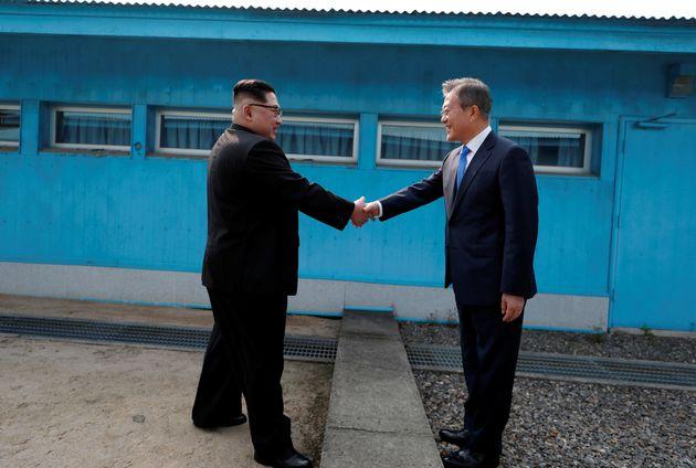 The two leaders shook hands before beginning talks behind closed