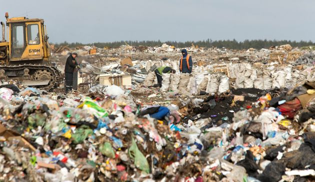Workers sort waste at the Ecores waste processing enterprise on the outskirts of Minsk, March 12,