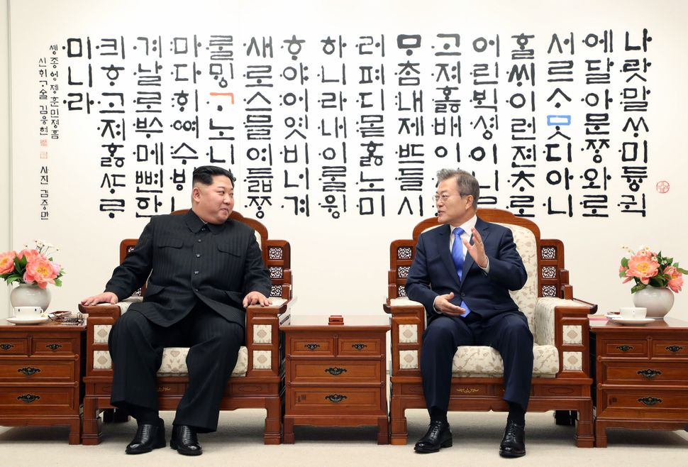 The leaders talk during the inter-Korean Summit.
