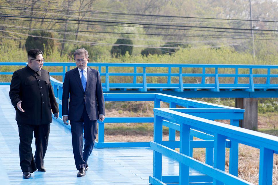 The leaders take a walk on the walk bridge.