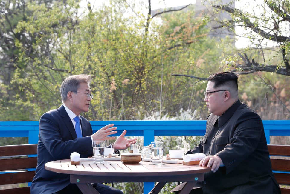The leaders talk in private over a meal.