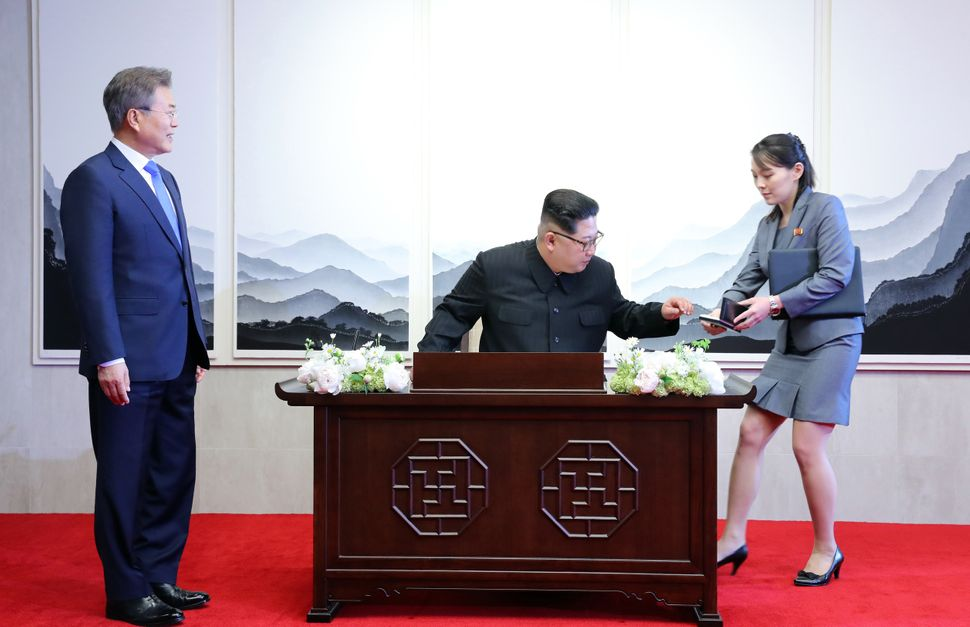 Kim signs the guest book at the Peace House in Panmunjom, South Korea.