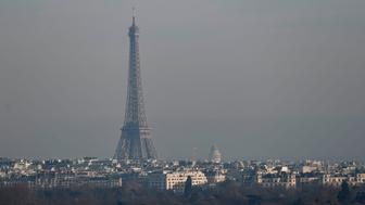 A haze of pollution is seen over the Eiffel Tower and the buildings of the city of Paris on December 16, 2016. The current surge in smog, trapped by cold weather and windless conditions, is the most serious in Paris in at least a decade, according to Airparif, which monitors pollution in the capital. / AFP PHOTO / PHILIPPE LOPEZ        (Photo credit should read PHILIPPE LOPEZ/AFP/Getty Images)