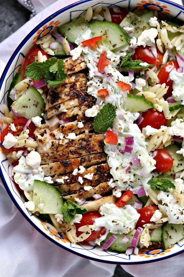 "<strong>Get the <a href=""https://www.cravingsofalunatic.com/greek-chicken-orzo-power-bowls/"" target=""_blank"">Greek Chicken Or"