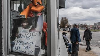 "A sign in a store reads ""Stop the violence"" in Baltimore, Maryland, U.S., March 30, 2018. REUTERS/Stephanie Keith"