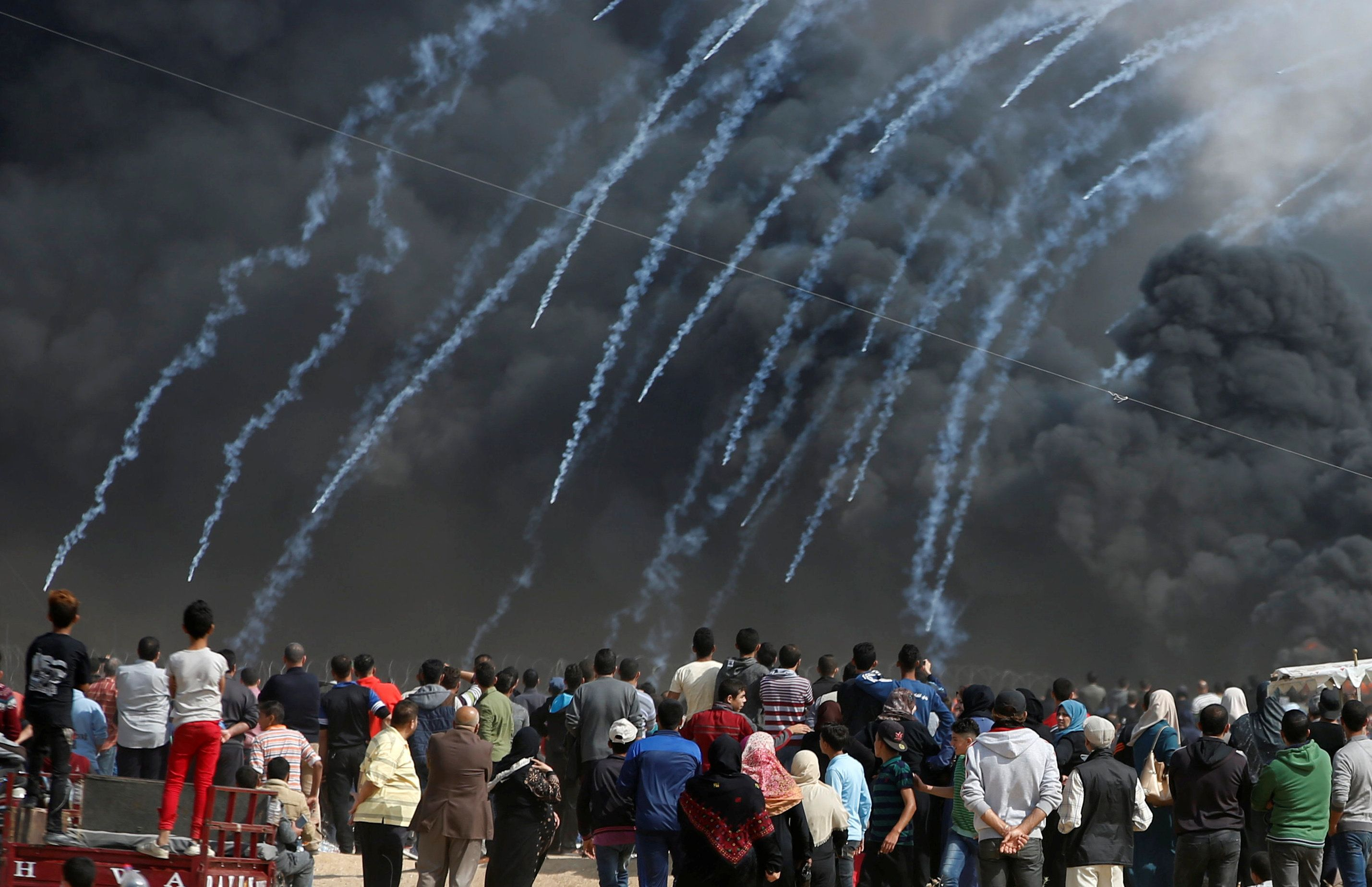 Tear gas canisters are fired by Israeli troops at Palestinian demonstrators during clashes at a protest demanding the right to return to their homeland, at the Israel-Gaza border, east of Gaza City, April 27, 2018. REUTERS/Mohammed Salem