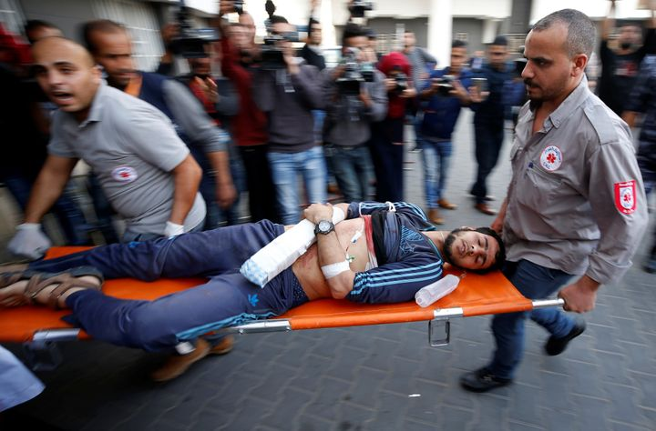 A Palestinian, who was wounded at the Israel-Gaza border, is carried into a hospital in Gaza City, April 27, 2018.