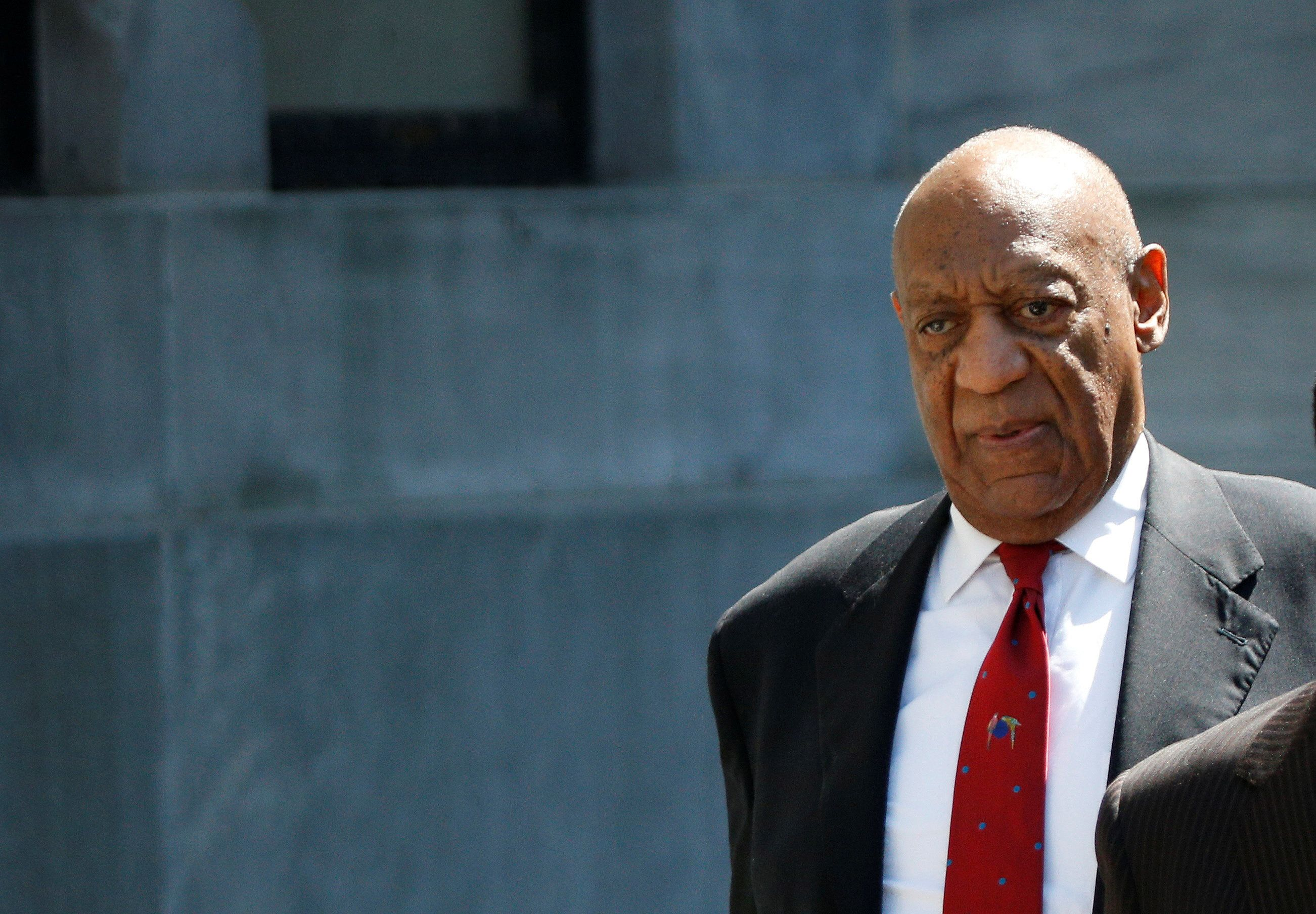 Bill Cosby exits the Montgomery County Courthouse after a jury convicted him in a sexual assault retrial in Norristown, Penns