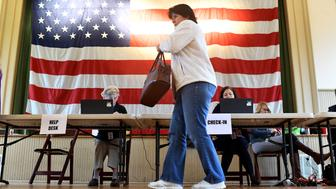 PURCELLIVLLE, VA - NOVEMBER 7: Debbie Rieger heads to the voting booth to cast her ballot at Hillsboro Old Stone School November 07, 2017 in Purcellivlle, VA.  (Photo by Katherine Frey/The Washington Post via Getty Images)