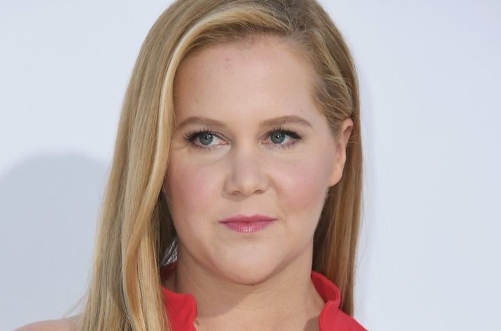 "Amy Schumer attends the premiere of ""I Feel Pretty."""