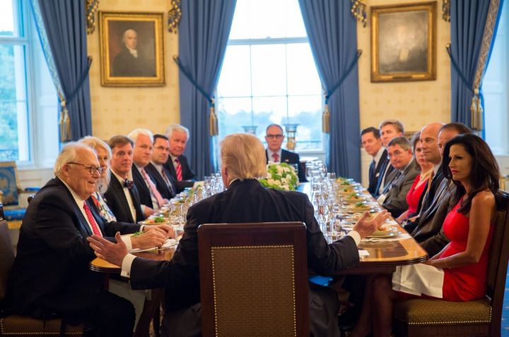 President Donald Trump hosts a dinner on Sept. 25, 2017, in the Blue Room at the White House with religious grassroots leader