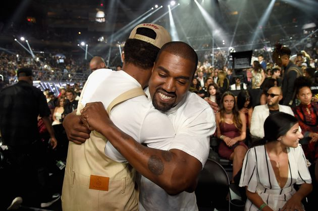 Chance and Kanye embracing at the 2016 VMAs