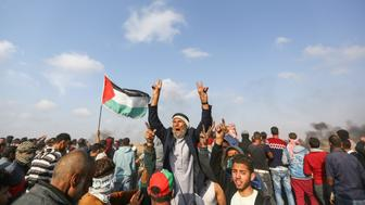 KHAN YUNIS, GAZA - APRIL 27: Palestinian stage a protest within 'Great March of Return' demonstration near Gaza-Israel border in Khan Yunis, Gaza on April 27, 2018. (Photo by Mustafa Hassona/Anadolu Agency/Getty Images)