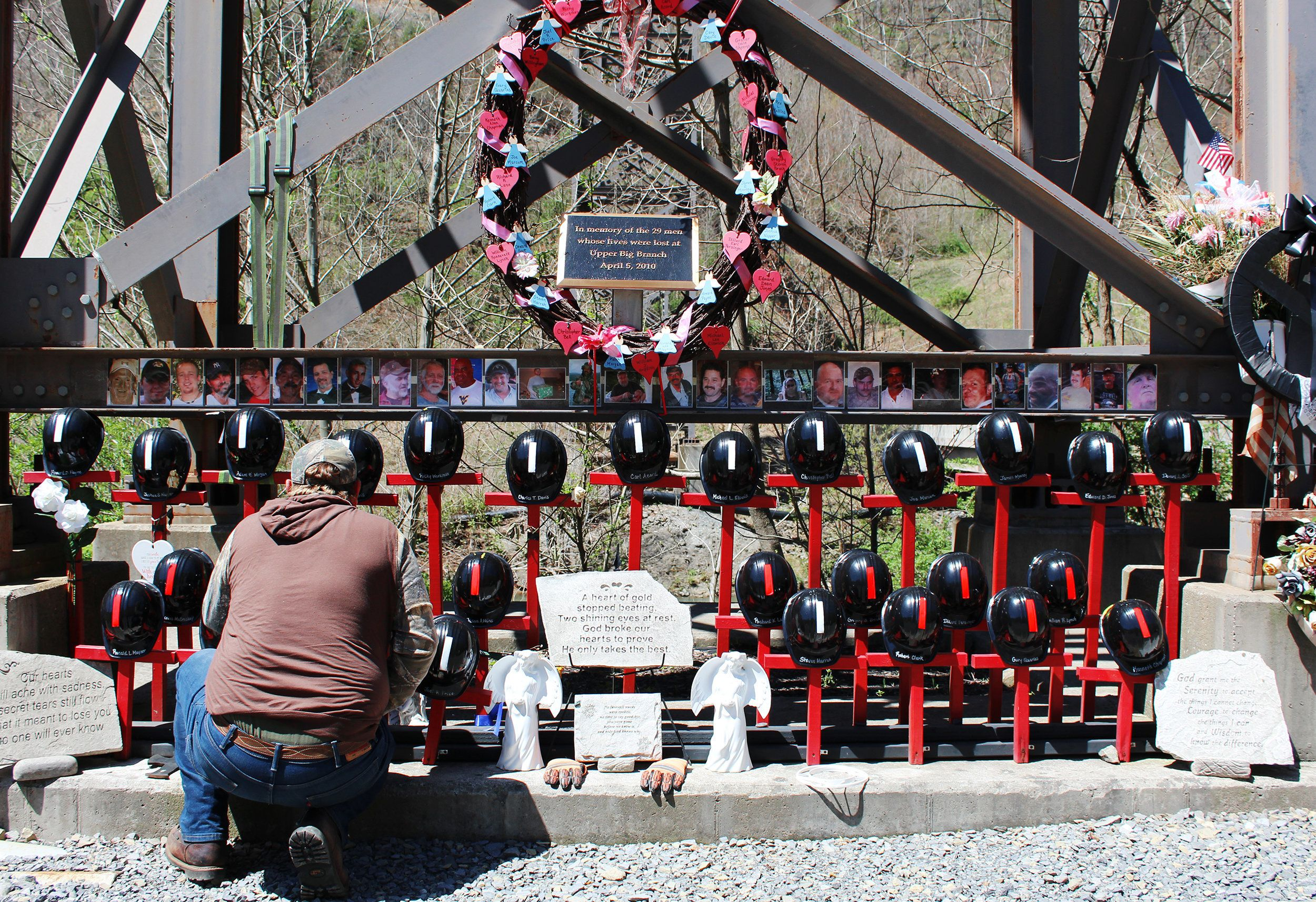 Davis kneels to tend to his son's memorial cross outside Upper Big Branch.