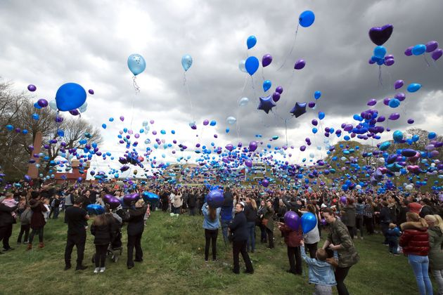 People release balloons outside Alder Hey Children's Hospital in Liverpool on
