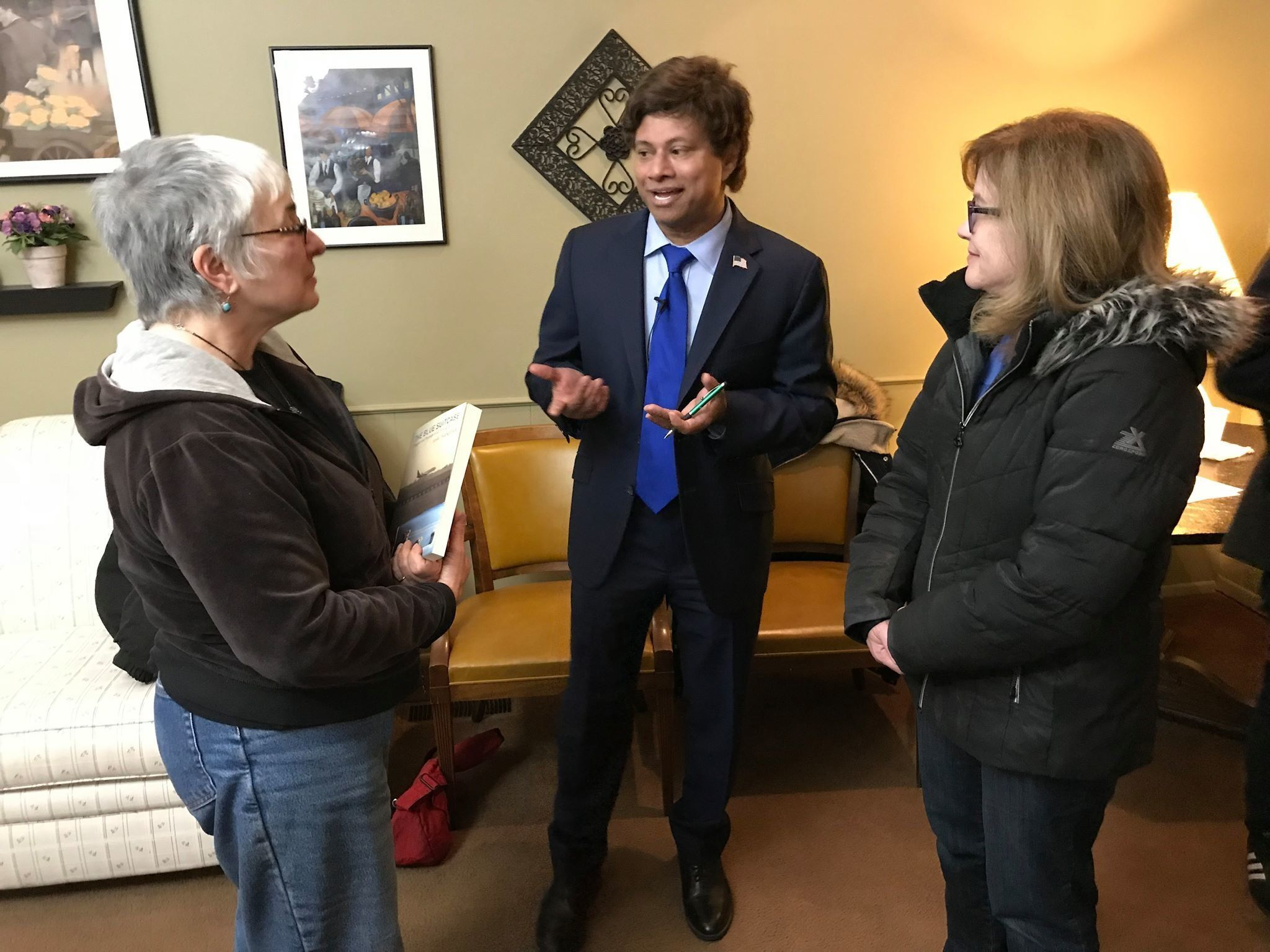 Democrat Shri Thanedar speaks to voters. Thanedar has drawn scrutiny for past business practices, including the treatment of
