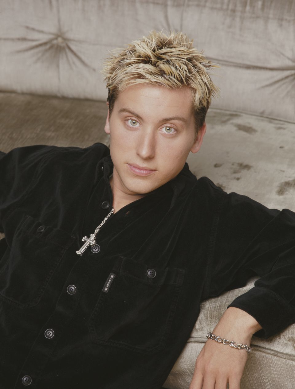 Lance Bass poses for a photo in