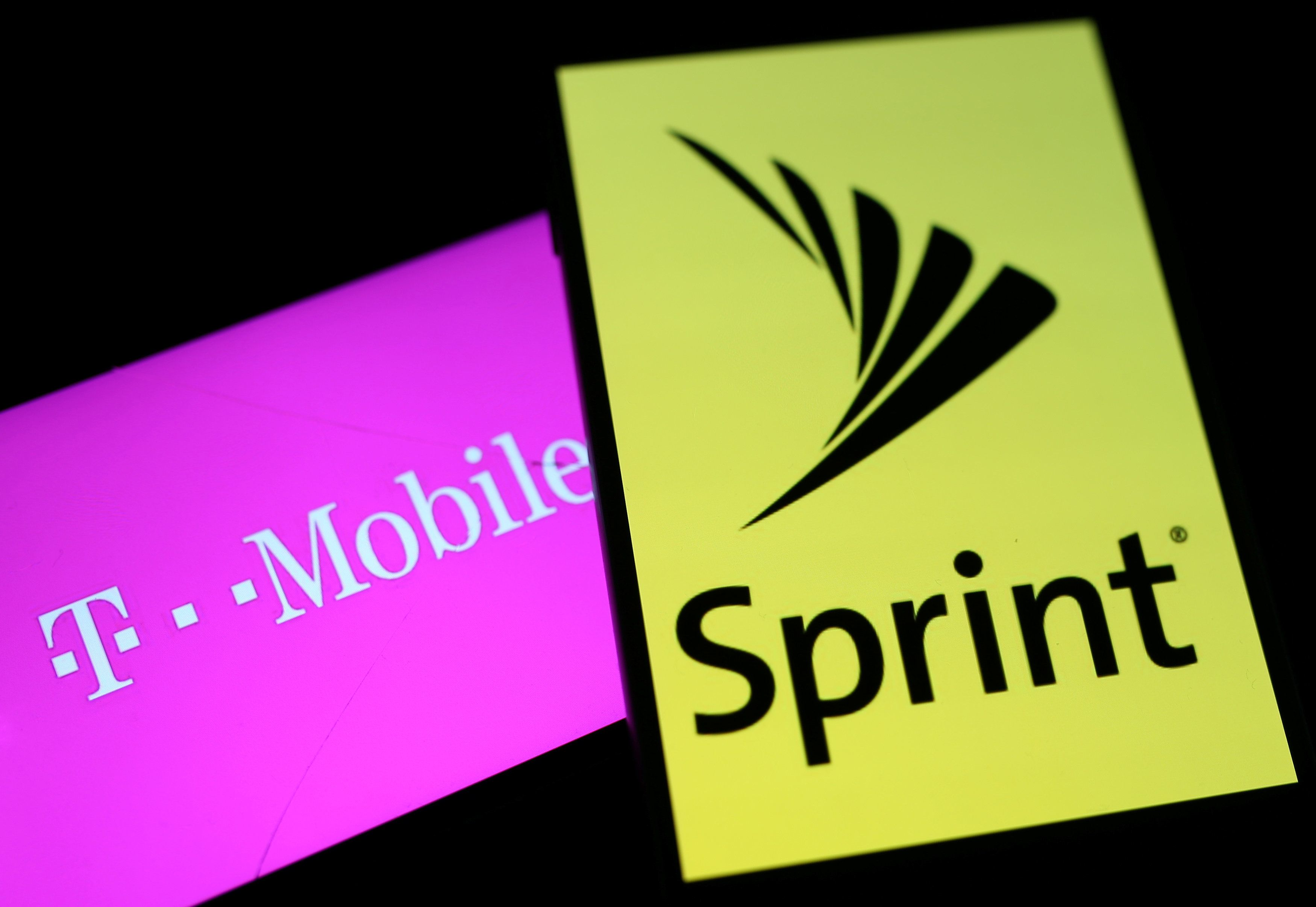 Smartphones with the logos of T-Mobile and Sprint are seen in this illustration taken September 19, 2017. (REUTERS/Dado Ruvic