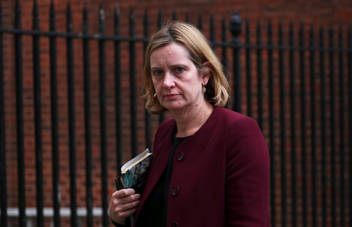 After repeated challenges to her testimony on the deportation of immigrants, Britain's Home Secretary Amber Rudd offered her