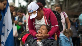 TIJUANA, MEXICO - APRIL 29: Members of a caravan of Central Americans who spent weeks traveling across Mexico walk from Mexico to the U.S. side of the border to ask authorities for asylum on April 29, 2018 in Tijuana, Baja California Norte, Mexico. More than 300 immigrants, the remnants of a caravan of Central Americans that journeyed across Mexico to ask for asylum in the United States, have reached the border to apply for legal entry.   (Photo by David McNew/Getty Images)